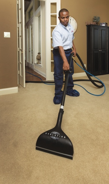 Service professional cleaning a carpet.