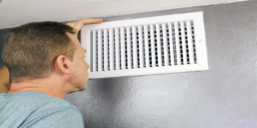 Man Doing Spring Air Duct Cleaning