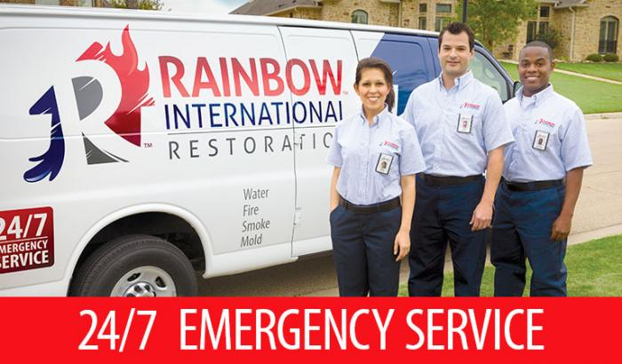 Rainbow International restoration professionals standing in front of van