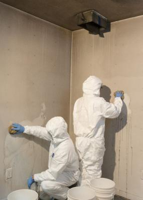 Restoration specialists cleaning fire damage.