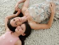 Picture of mom and daughter on clean carpet.